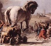 Greek horse being pulled into the city of Troy